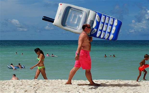 Inflatable mobile phone on beach